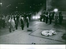 Urho Kaleva Kekkonen gathered with other people during a funeral 1962