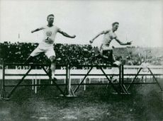 Contestents at Olympic Games jumping hudle.