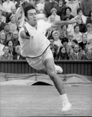 Ken Rosewall was in action during the match against Cliff Richey in Wimbledon in 1971
