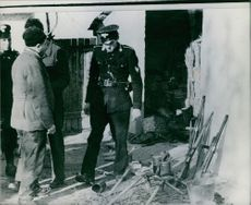 1941 The searching authorities confront a farmer with a small arsenal.