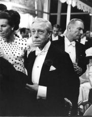 Edward VIII standing in a party.