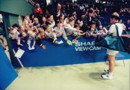 Stefan Edberg writes autographs during the Stockholm Open.