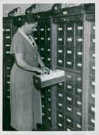 Dagmar H. checks a card register