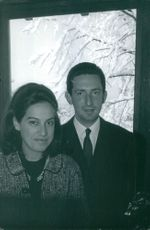 Prince Michael of Greece and Denmark photographed with a woman.