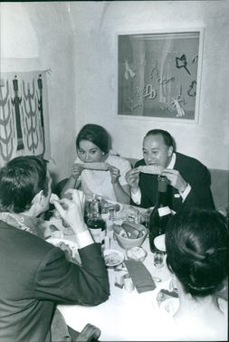 Claudine Auger eating corns with friends.