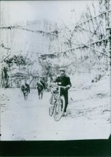 Soldier cycling in street.
