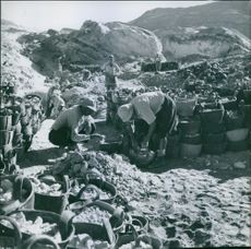 Workers collecting rocks at the coaline.