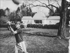 """Robert Francis """"Bobby"""" Kennedy catching."""