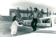 Press officer Yannick Collard receives actor Jack Nicholson on his arrival at Deauville airport