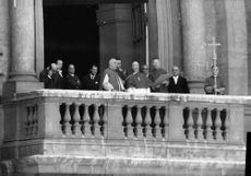 Pope Paul VI standing with people.