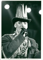 Boy George on stage performing