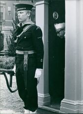 Soldiers guarding in the door while another man looking at him. 1968