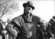 """Michael Cormac """"Mike"""" Newell standing wearing a hat."""