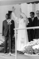 Pope Paul VI waving to people.
