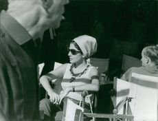 Princess Soraya relaxing on chair and wearing sunglasses.