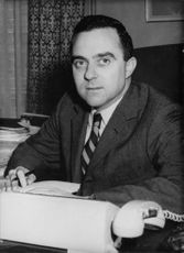 Joseph A. Califano at his desk, in office.