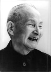 Chen Yun laughing.