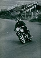Lord Snowdon riding a twin Triumph 500 motorcycle at a speed of 90 m.p.h. was taken in the summer of 1965.