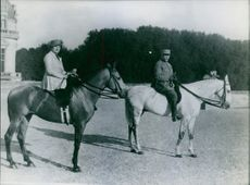 Philippe Petain enjoying horse ride along with another man. 1962