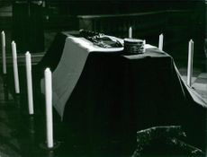 A coffin with a German flag.