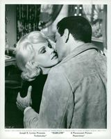 Carroll Baker kissing a man.