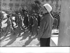 Soldiers marching in the street during Algerian War, 1960.