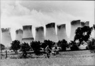 Cyclist poses in front of nuclear power plants in England