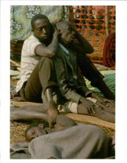 The Rwandan War:A Rwandan refugees comforts his dying father.