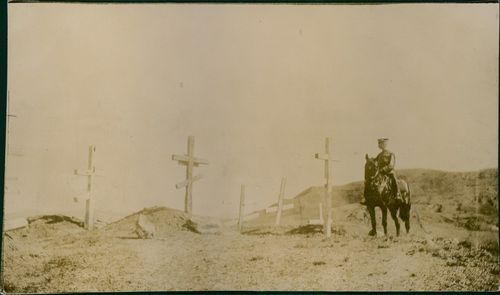 Vintage photo of a soldier visiting Russian soldier graves at Liao Yang in August 26-September 3, 1904.