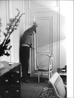 Danny Kaye standing by door
