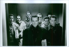 A photo of actor William Sadler as Colonel Stuart with his group of terrorists in the 1990 film Die Hard 2.