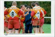 French rugby club Poitiers coach Sandrine Cheiffaud standing on schedule amongst the players