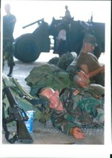 The Rwandan War:US Army soldiers take a rest while air force soliers man.d