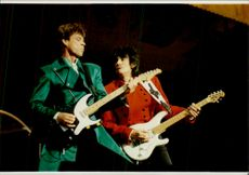Mick Jagger and Ron Wood play during the Rolling Stones concert at Wembley