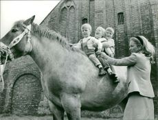 Prince Albert II`s kids riding on a horse as his wife looks on.