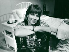 The actress and director Gunnel Lindblom sit back on a chair during the break of a recording.