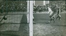 Footballers playing football, made a goal during match. 1928