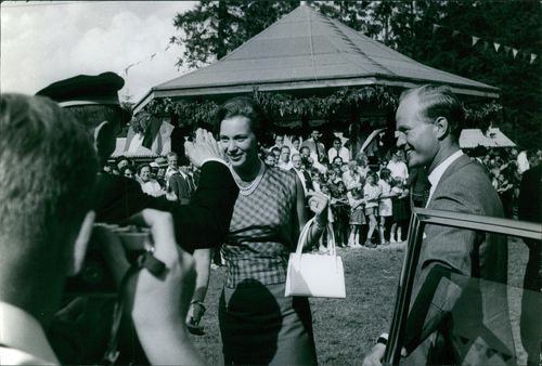 Prince Richard and Princess Benedikte being welcomed by the people, and smiling.