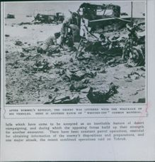 """After Rommel's retreat, the desert was littered with the wreckage of his vehicles. here another batch of """"written-off"""" German material, 1942."""