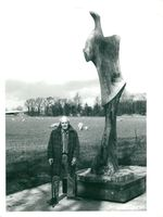 "Sculptor Henry Moore next to his sculpture ""Standing Figure - Knife Edge"""