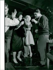 Sacha Distel dancing with a woman on the dance floor.  Taken - 23 Oct. 1961