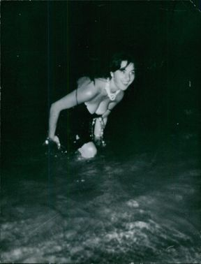 An attractive lady bathing in waters. 1950