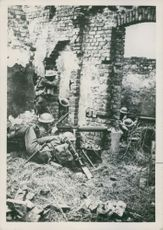 Soldiers hiding in a abandoned house.