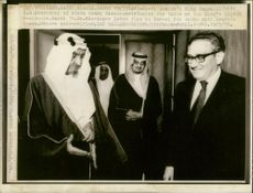Dr. Henry Kissinger with king Faisal.