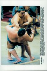 American born summits Masashumaru (above) in close combat against Akebono during the Summer Grand Sumo tournament.