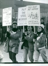 Women pickets demonstrating in the street.