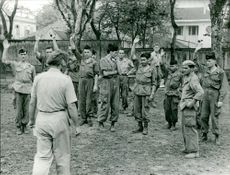 Soldiers raising their hands in front of the officer in Điện Biên Phủ, 1969.