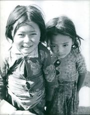 A photograph of two young Nepalese children.