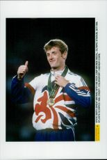 Steve Smith (UK) with his bronze medal in high jump