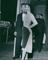 Actress Julia Adams with her date George Nader attend a Hollywood function. 1954.